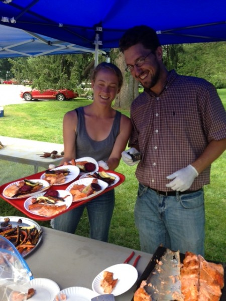 Sarah Archbald and Tom O'Dowd (Environmental & Urban Studies, Bard College) prepare to serve veggies and steelhead.